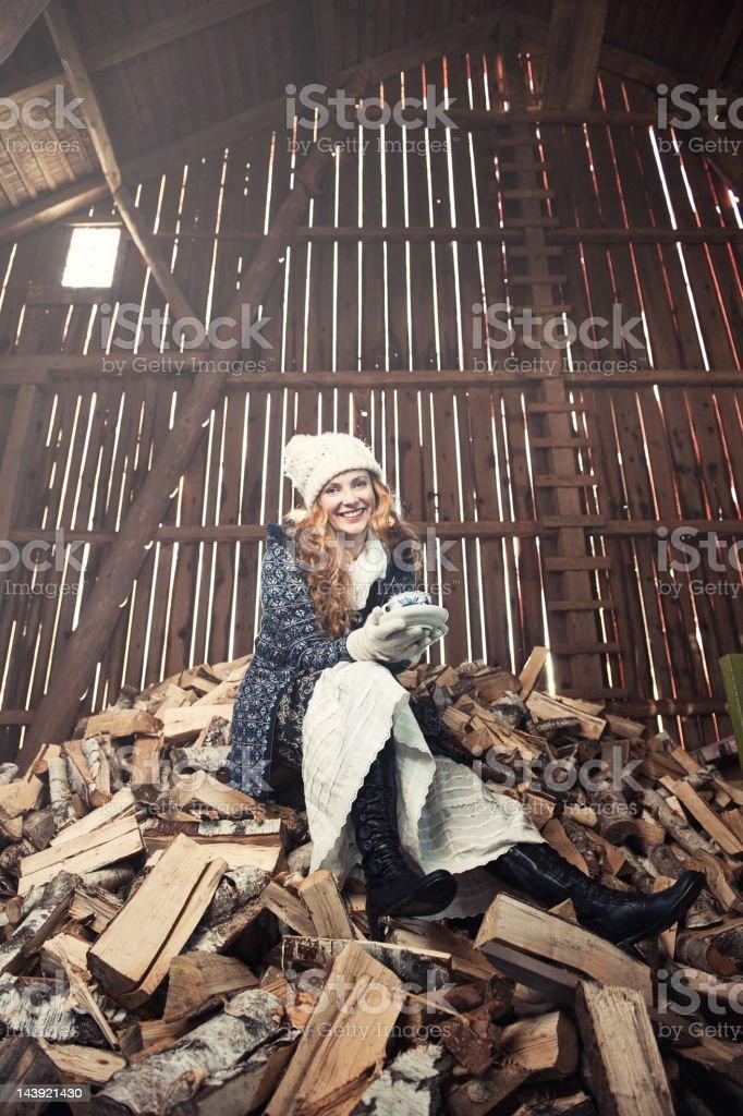 Beautiful woman inside a barn royalty-free stock photo