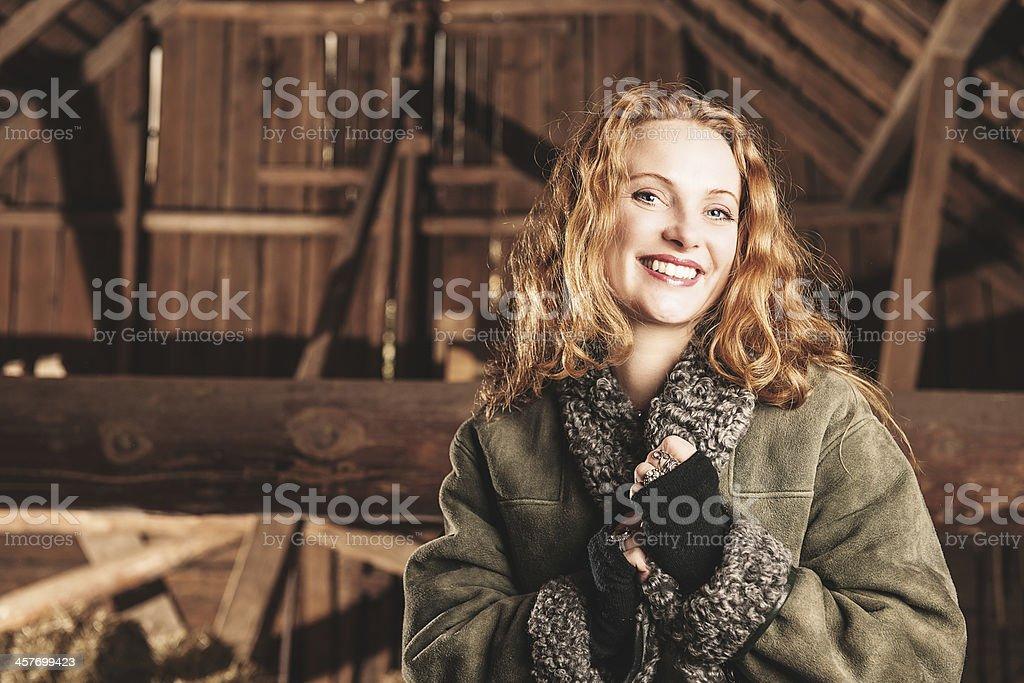 Beautiful woman inside a barn stock photo
