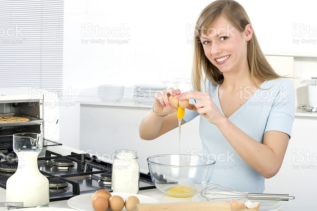 Beautiful woman into the kitchen royalty-free stock photo