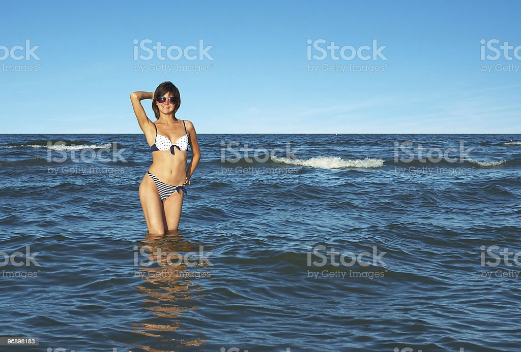 Beautiful woman into the water royalty-free stock photo