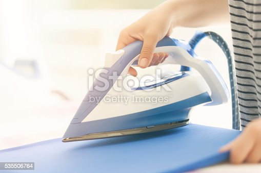 istock beautiful woman ironing some clothes 535506764