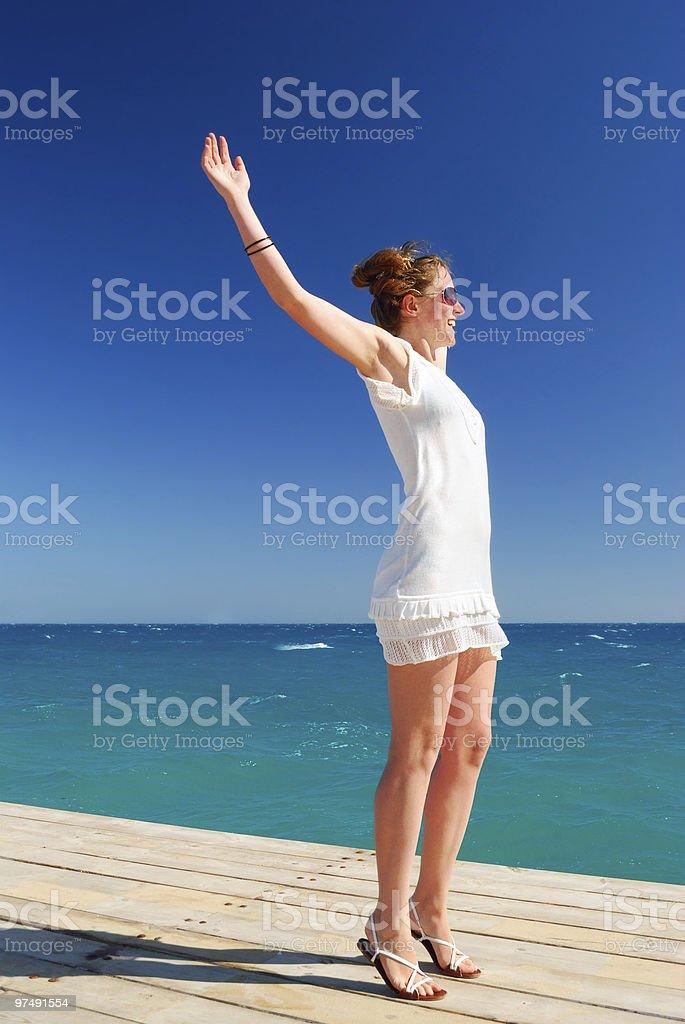 beautiful woman is enjoying the sea freedom royalty-free stock photo