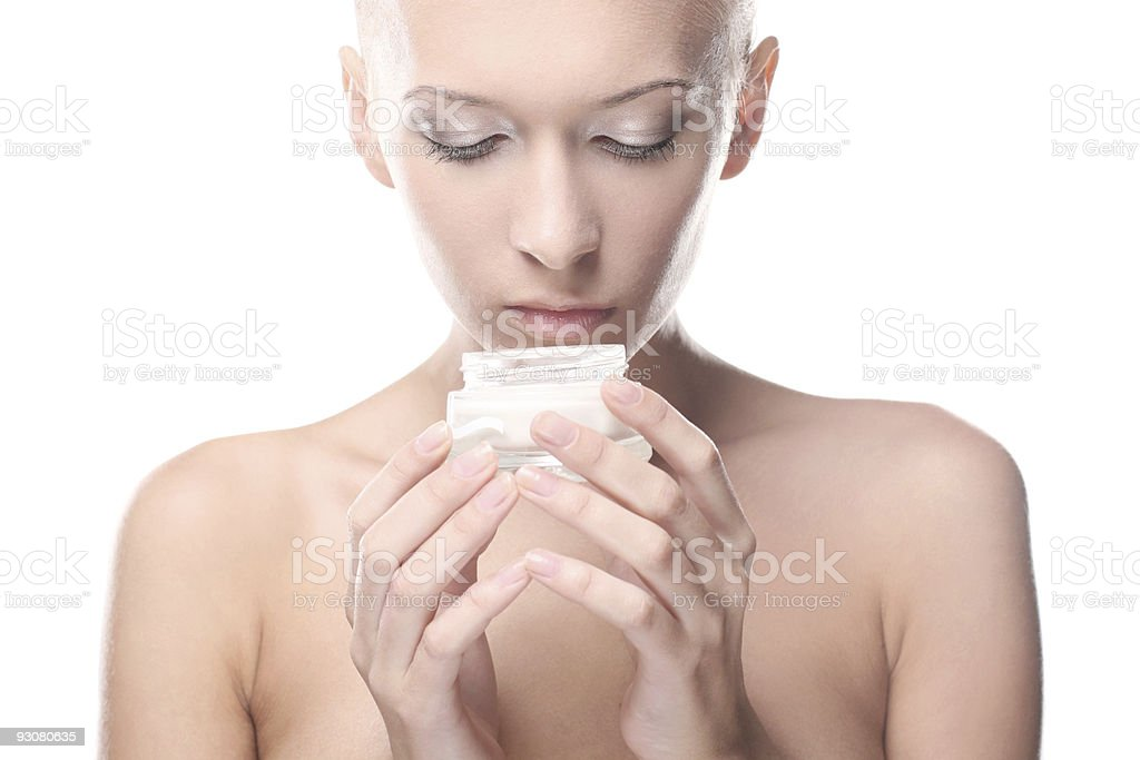 Beautiful woman is holding a cream in her hand royalty-free stock photo