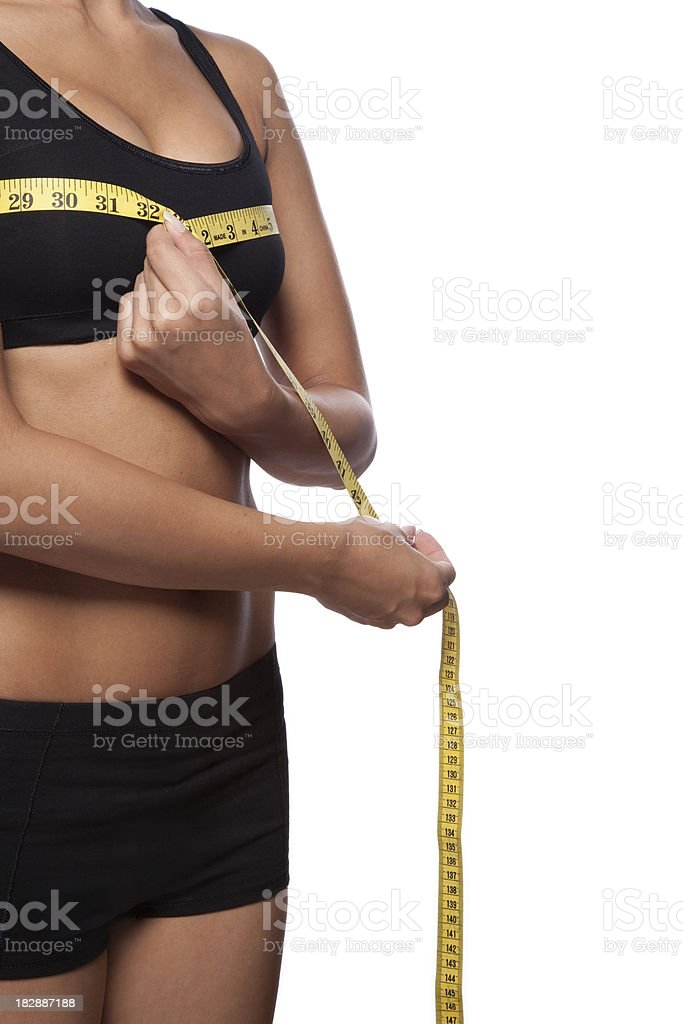 Beautiful woman is measuring her breast stock photo