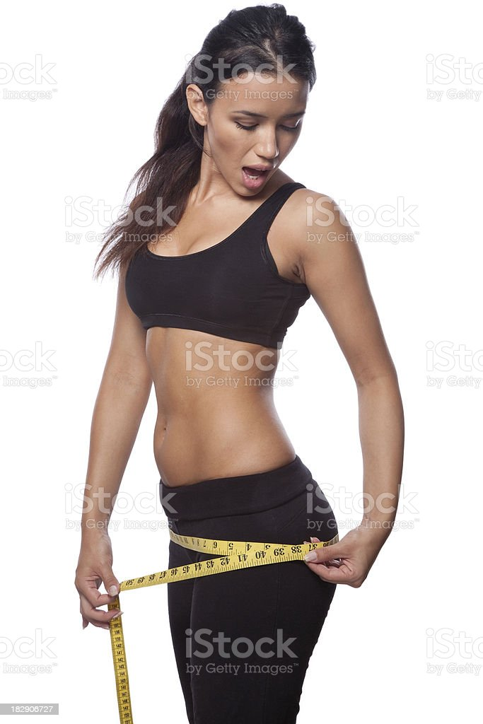 Beautiful woman is measuring her hips stock photo