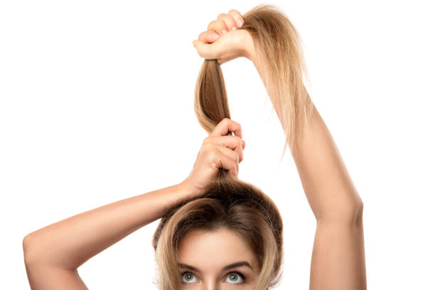 Beautiful woman is very happy of her hair growth progress stock photo