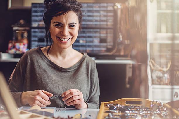 Beautiful woman jewelry maker stock photo