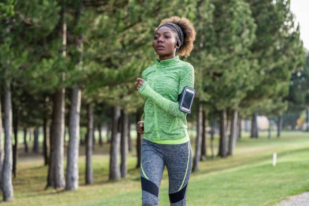 Beautiful woman jogging on the street in the neighborhood stock photo