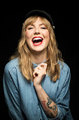 Beautiful woman laughing against black background