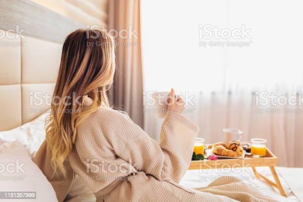 Beautiful woman laying and enjoying breakfast in bed picture id1151357999?b=1&k=6&m=1151357999&s=612x612&h=eqfv4n7q3 scodeguwo7w70c9tbtn1xgxpbp10nlg e=