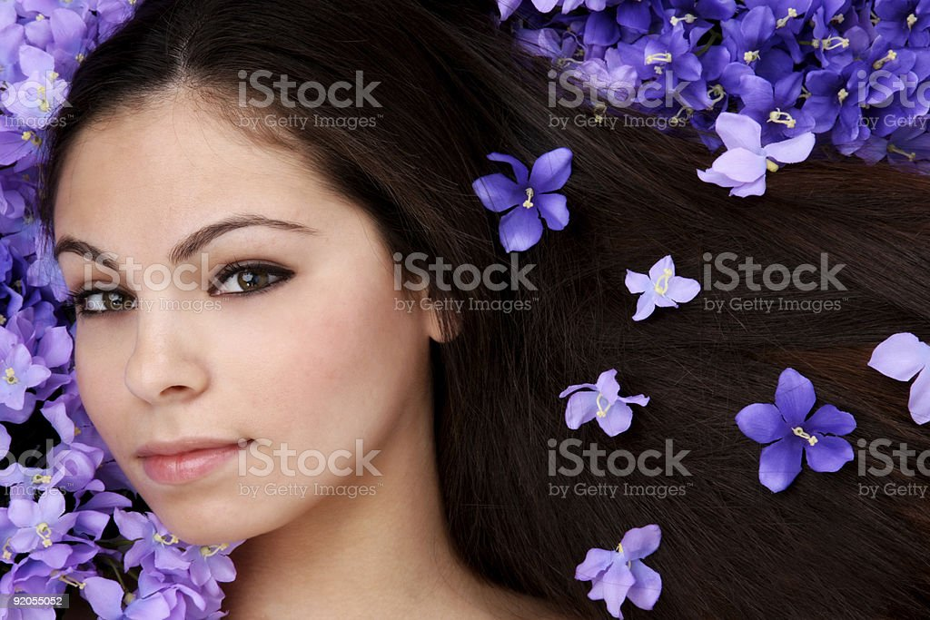 Beautiful woman laying in bed of flowers royalty-free stock photo