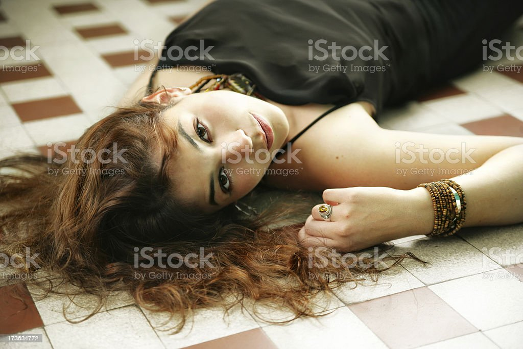 Beautiful woman laying on the floor royalty-free stock photo