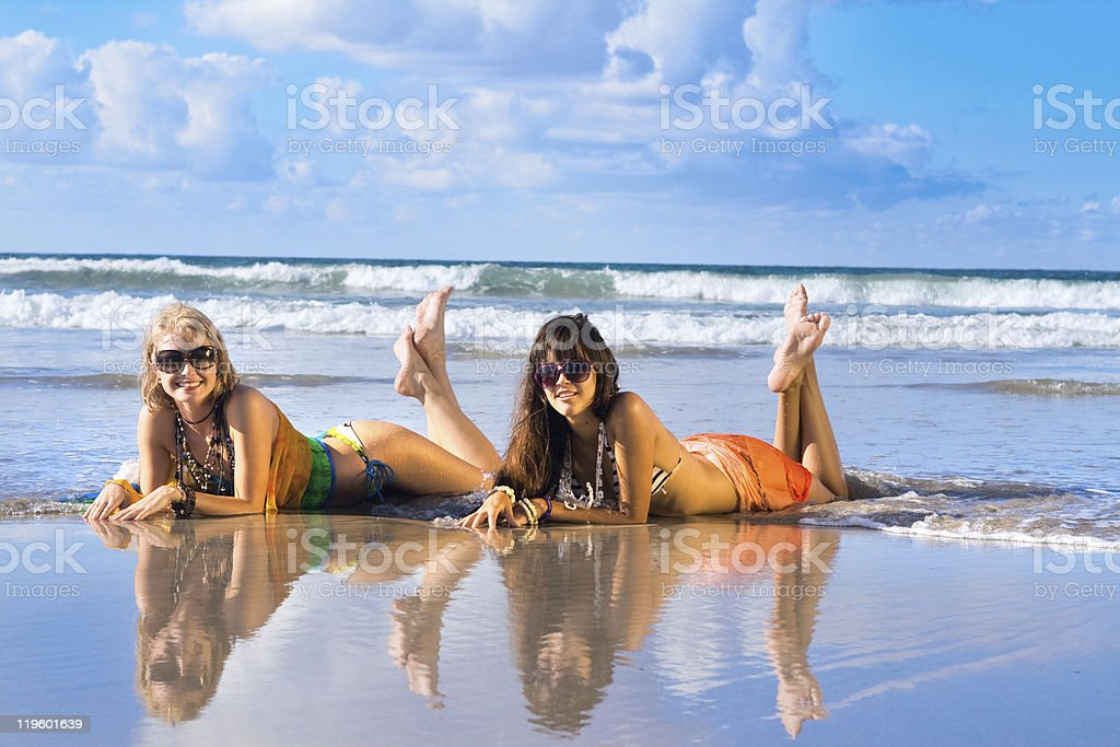 beautiful woman lays on beach stock photo