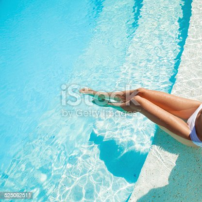 istock Beautiful woman legs in swimming pool. 525062511