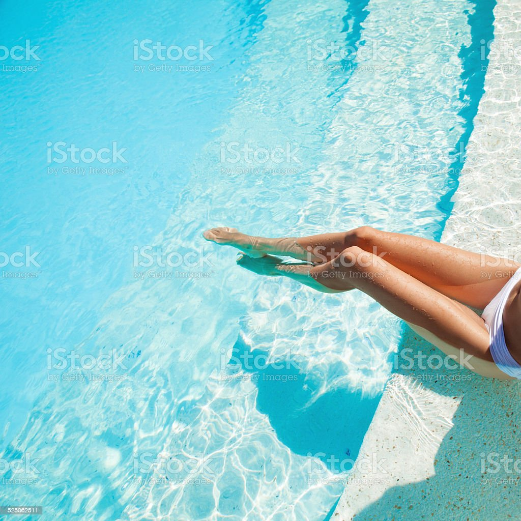 Beautiful woman legs in swimming pool. stock photo