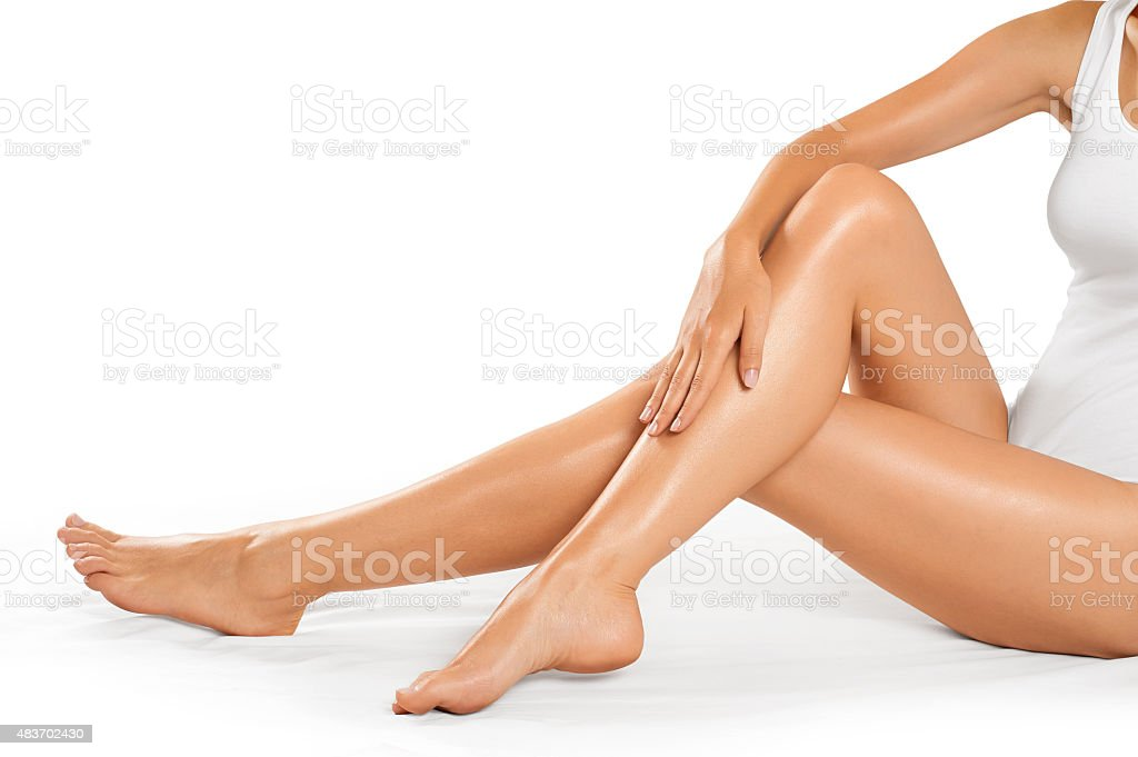 Beautiful woman legs on a white background. stock photo