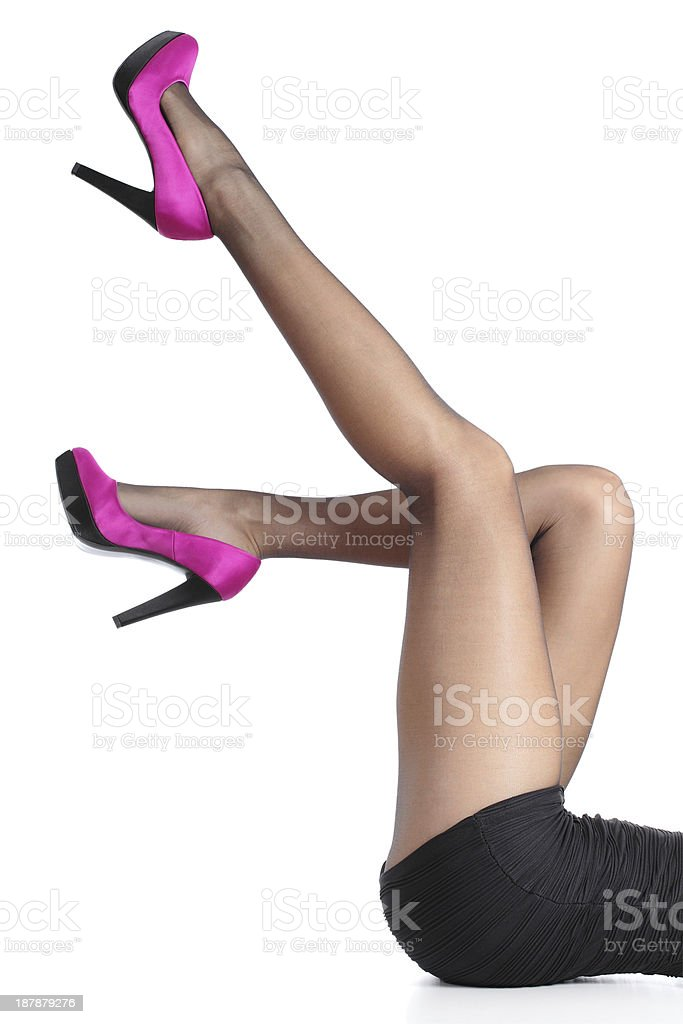 Beautiful woman legs with fuchsia high heels and black tights stock photo