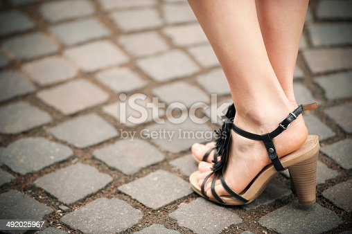 157582133 istock photo Beautiful Woman Legs with High Heels Sandals 492025967