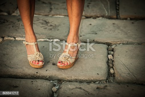 157582133 istock photo Beautiful Woman Legs with High Heels Sandals 505341212
