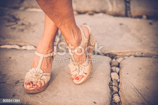 157582133 istock photo Beautiful Woman Legs with High Heels Sandals 505341394