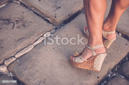 157582133 istock photo Beautiful Woman Legs with High Heels Sandals 505341596