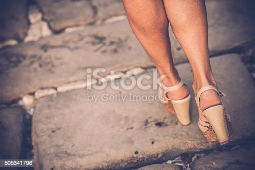 157582133 istock photo Beautiful Woman Legs with High Heels Sandals 505341796
