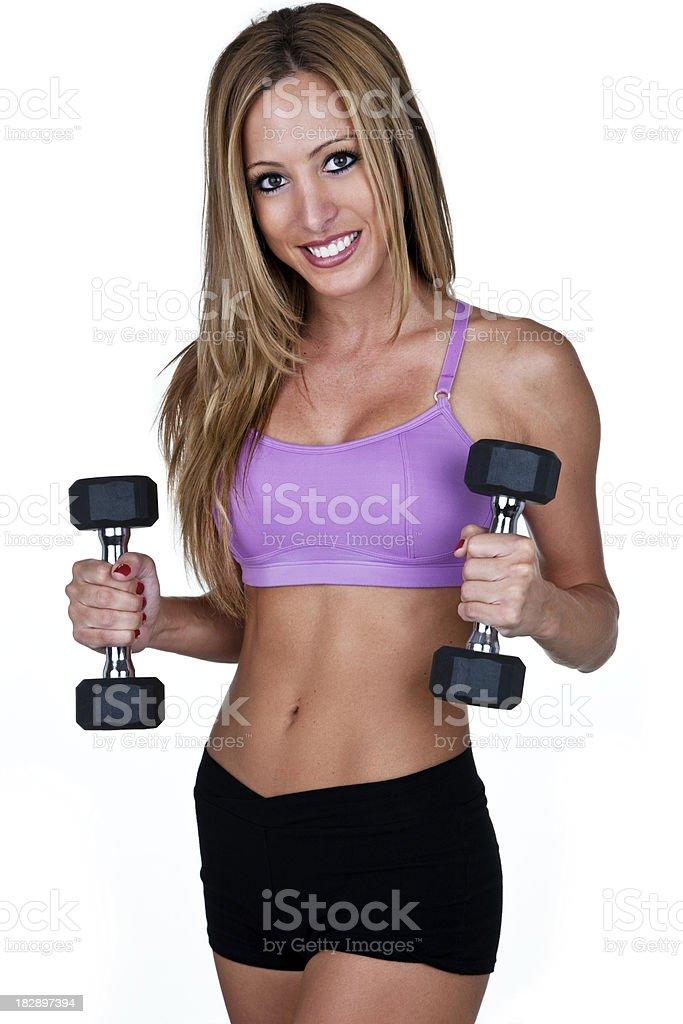 Beautiful woman lifting weights royalty-free stock photo