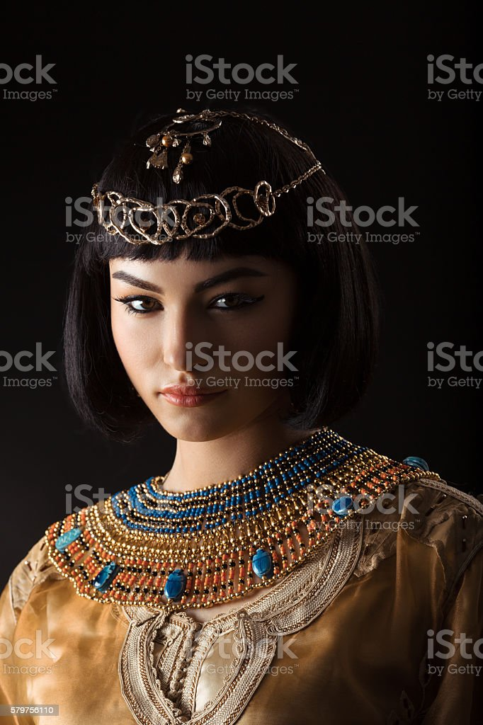 Beautiful woman like Egyptian Queen Cleopatra with serius face on stock photo