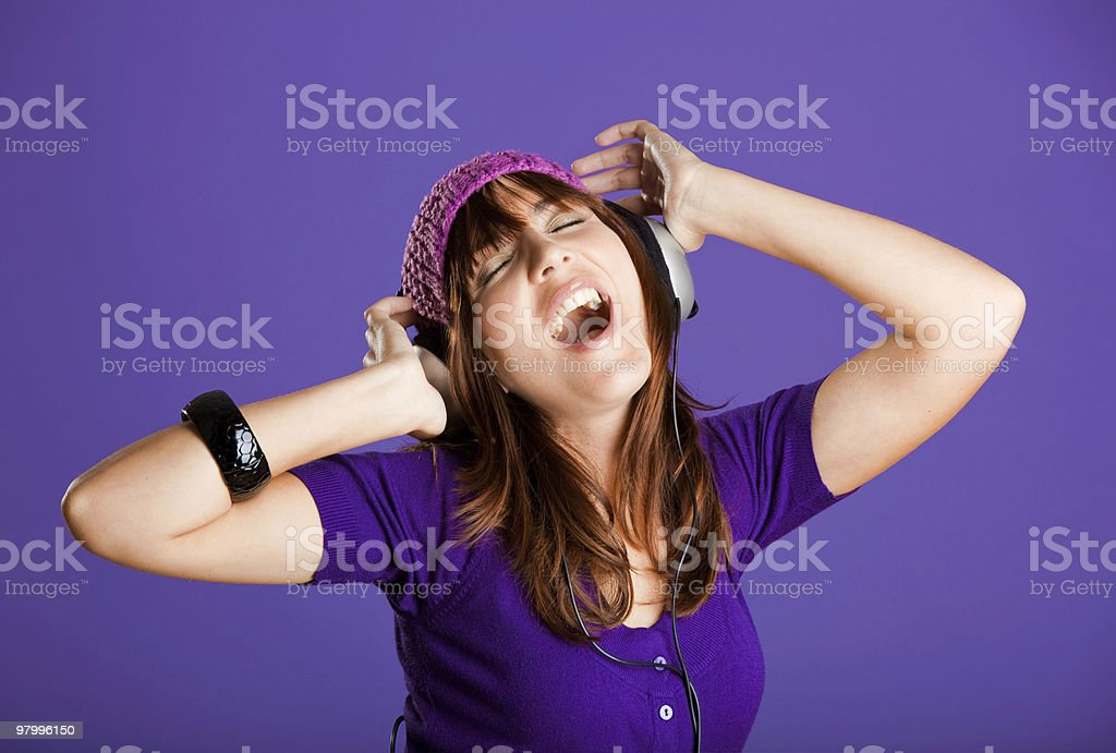 Beautiful woman listening music royalty free stockfoto