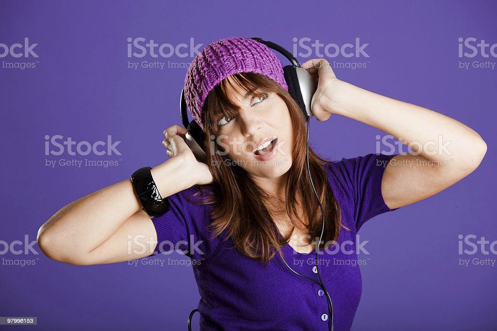 Beautiful woman listening music royalty-free stock photo
