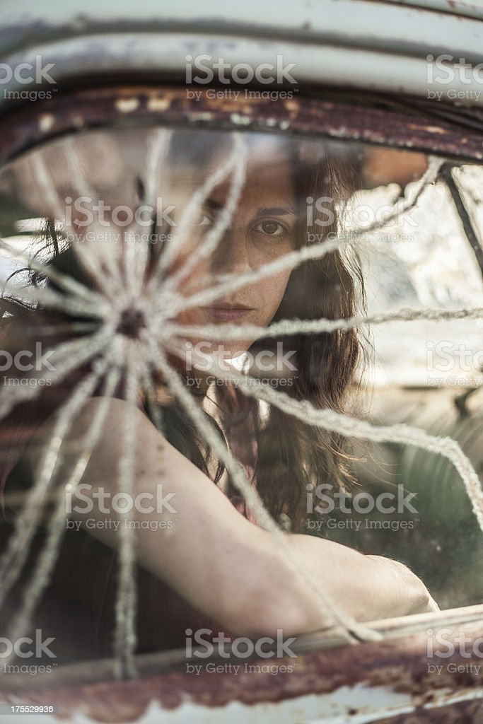 This is a color image of a beautiful dark haired woman sitting in a...