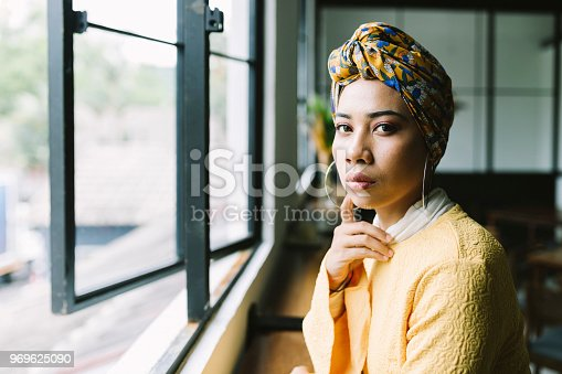 Beautiful woman contemplating in a cafe.