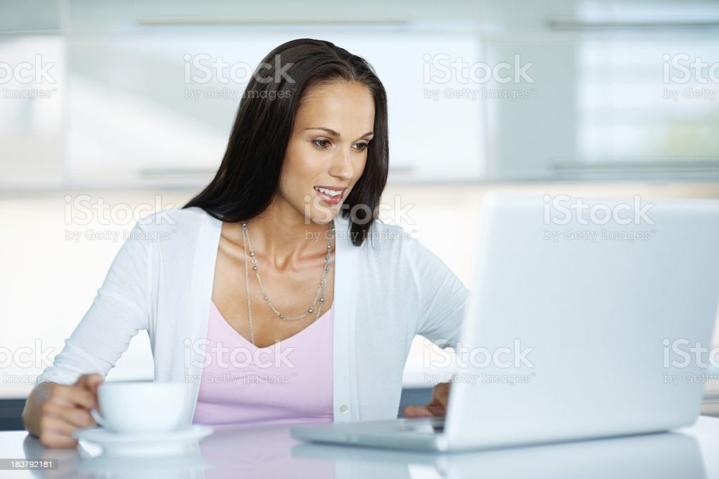 Beautiful woman looking at her laptop royalty-free stock photo