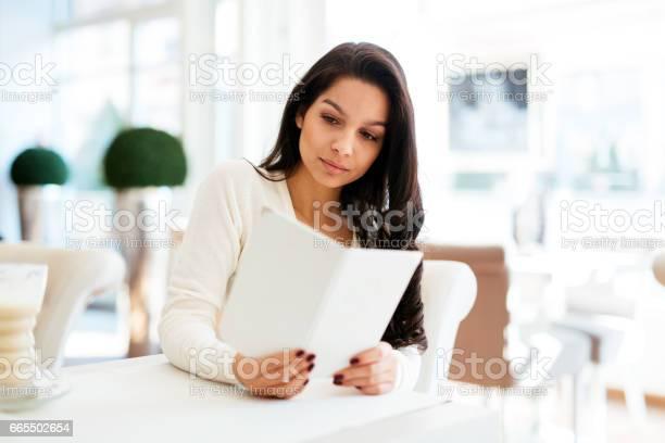 Beautiful woman looking at menu in restaurant picture id665502654?b=1&k=6&m=665502654&s=612x612&h=zyc3ccswnzyjav0g3z7cxtztazh0tt7vo5ru2mep1dw=