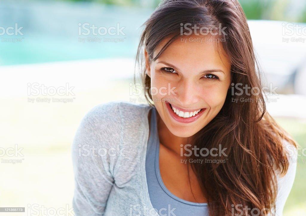 Beautiful woman looking at you stock photo