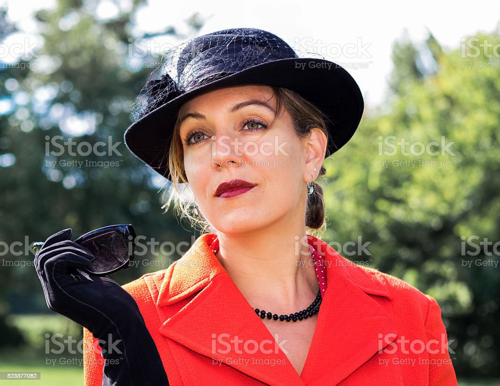 Beautiful woman looking dreamily stock photo