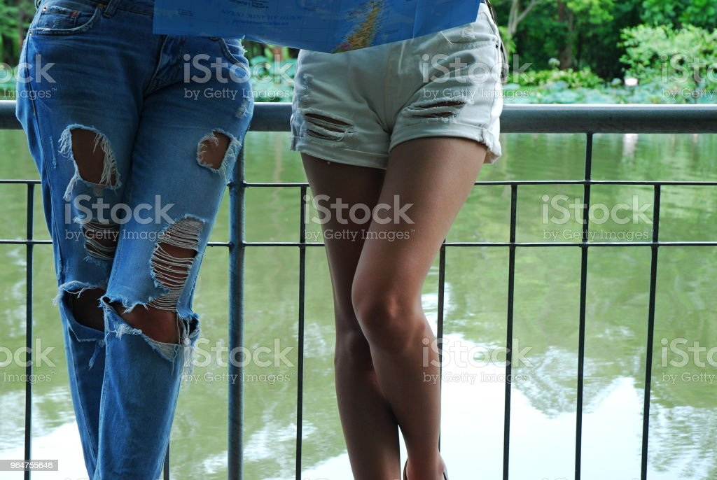 beautiful woman looking map for travel in summer weekend. royalty-free stock photo