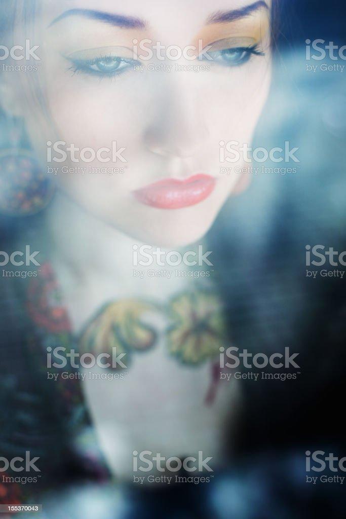 Beautiful woman looking  window royalty-free stock photo