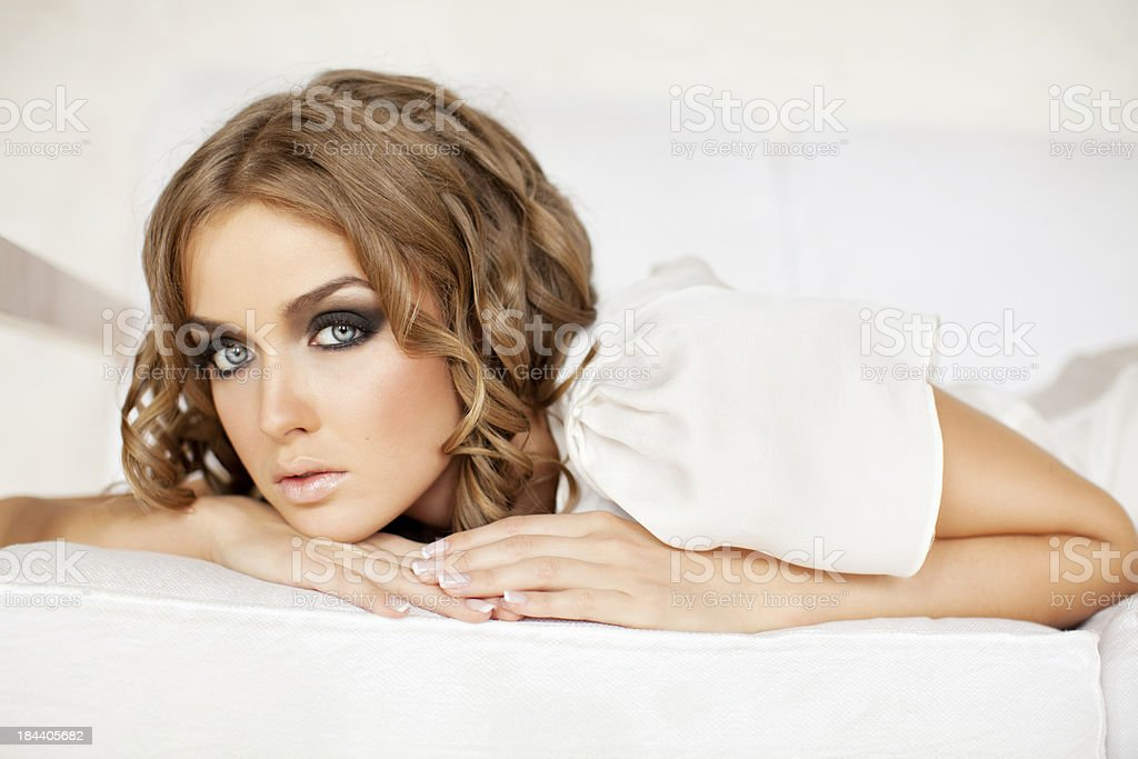 Beautiful woman lying down on the bed royalty-free stock photo