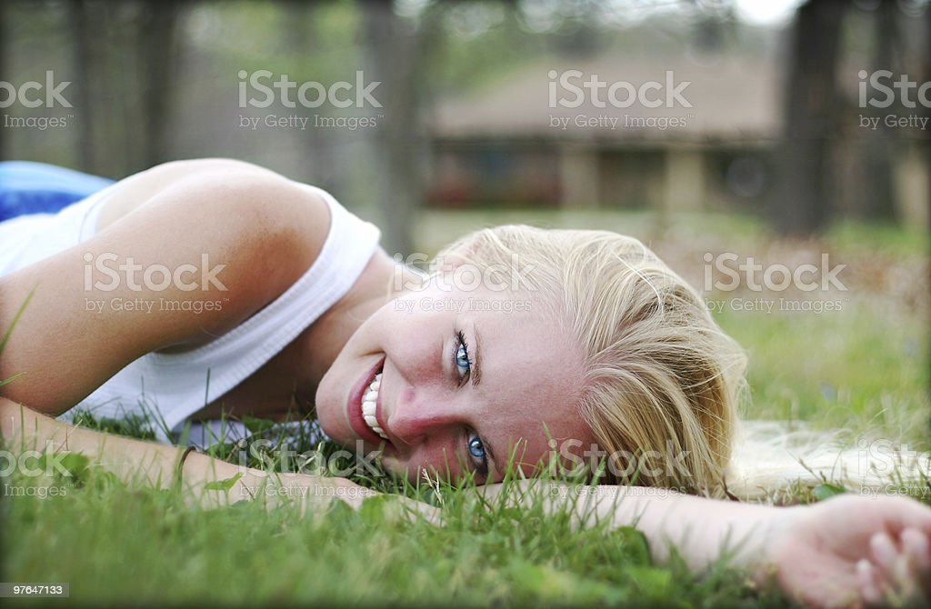 beautiful woman lying down royalty-free stock photo