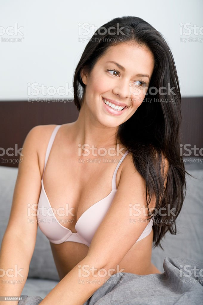 Beautiful woman lying in bed royalty-free stock photo