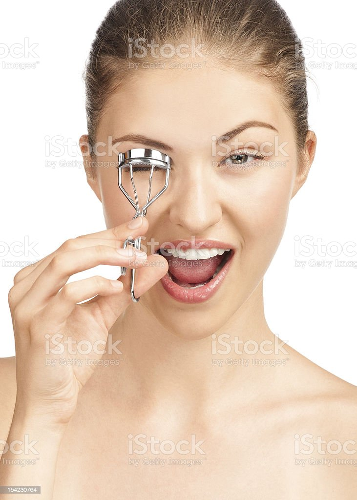 Beautiful woman making curl eyelashes stock photo