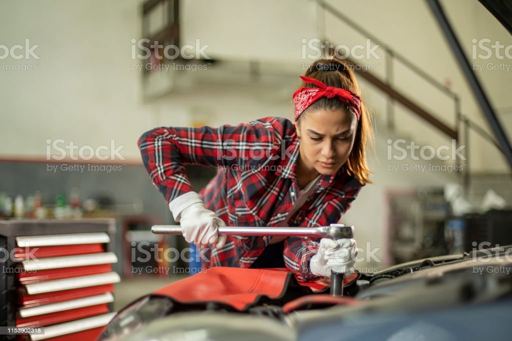 Portrait of young , beautiful and proud female mechanic.