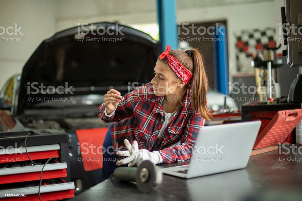 Portrait of young, beautiful and proud female mechanic.