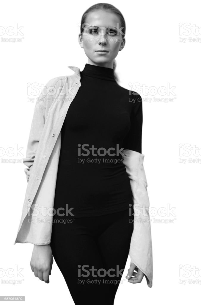 Beautiful woman model in black posing isolated on background, black and white photo Lizenzfreies stock-foto