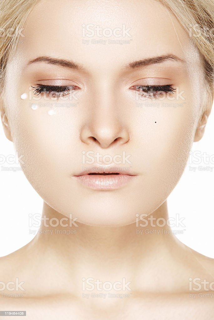 Beautiful woman model with day cream near eye stock photo