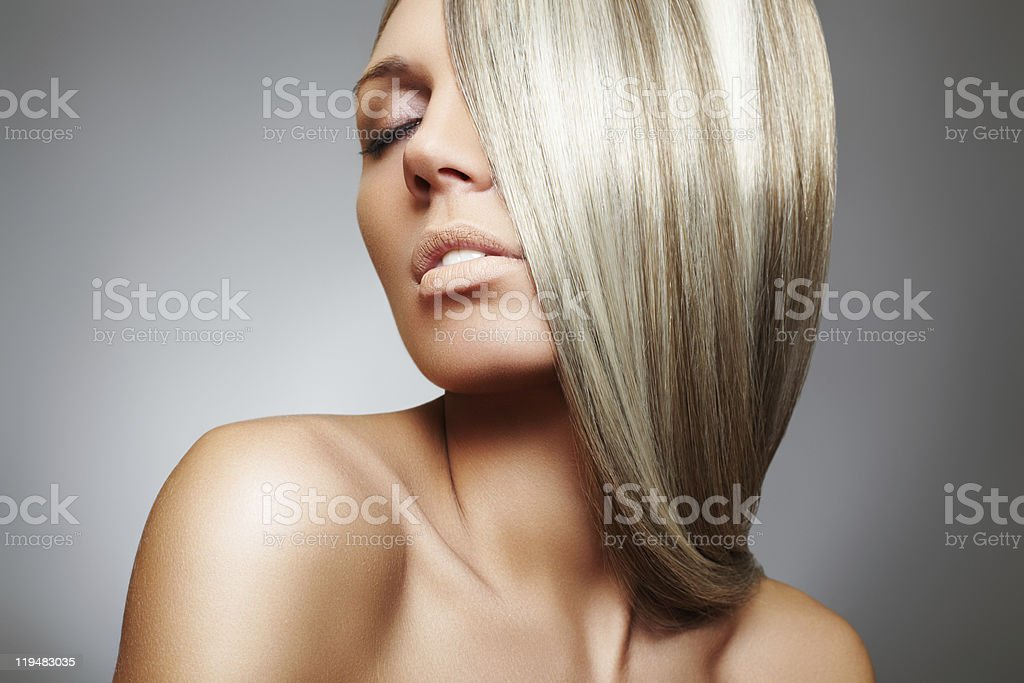 Beautiful woman model with long blond smooth hair stock photo
