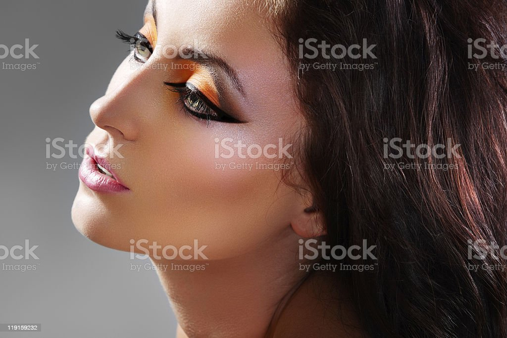Beautiful woman model with luxury oriental make-up stock photo
