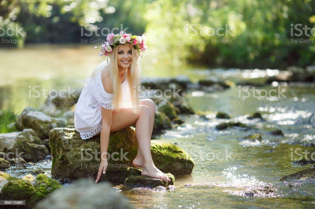Beautiful woman near a mountain river royalty-free stock photo