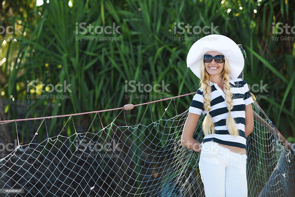 Beautiful woman near the fishing net royalty-free stock photo